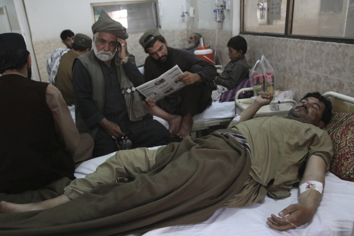People visit their family member who survived a bombing, at a hospital in Quetta, Pakistan, Thursday, July 26, 2018. The suicide attack outside the polling station in Quetta which killed dozens of people, underscored the difficulties the majority Muslim nation faces on its wobbly journey toward sustained democracy. (AP Photo/Arshad Butt)