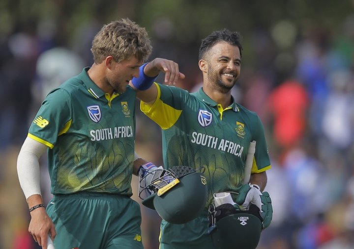 South Africa's Jean-Paul Duminy, right, and Willem Mulder celebrate their victory over Sri Lanka by five wickets in the first one day international cricket match in Dambulla, Sri Lanka, Sunday, July 29, 2018. (AP Photo/Eranga Jayawardena)