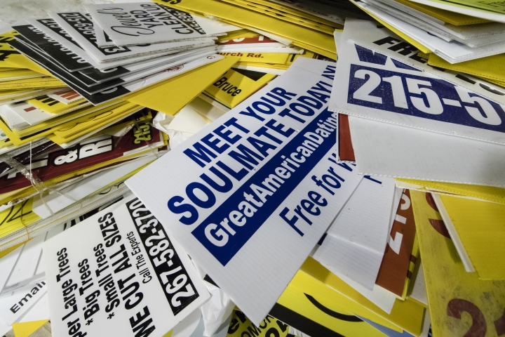 This July 18, 2018, photo shows illegally posted signs collected by citizens groups, in Philadelphia. Citizens have collected more than 8,500 signs from around the city in the action billed as the Bandit Signs Brigade. In the fall, the signs will be transformed by local artists and designers into something useful. (AP Photo/Matt Rourke)