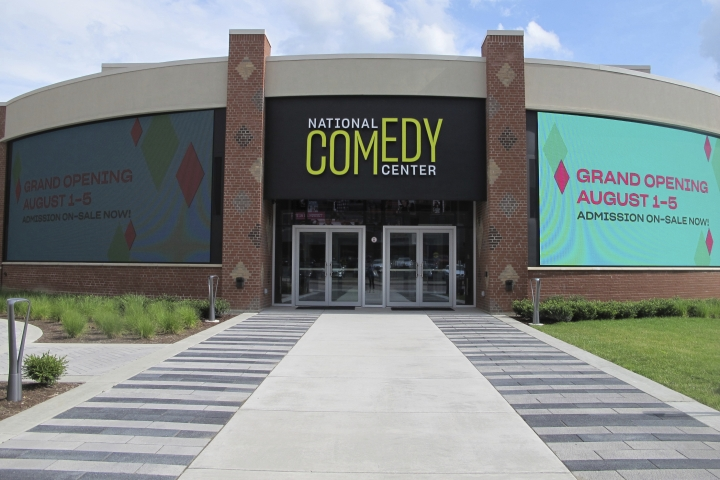 In this July 24, 2018 photo, the main entrance to the National Comedy Center in Jamestown, N.Y. is shown. The center was inspired by the late Lucille Ball, who wanted her hometown to be a destination for people to learn about and celebrate comedy as an art form. Its grand opening celebration starts Aug. 1. (AP Photo/Carolyn Thompson)