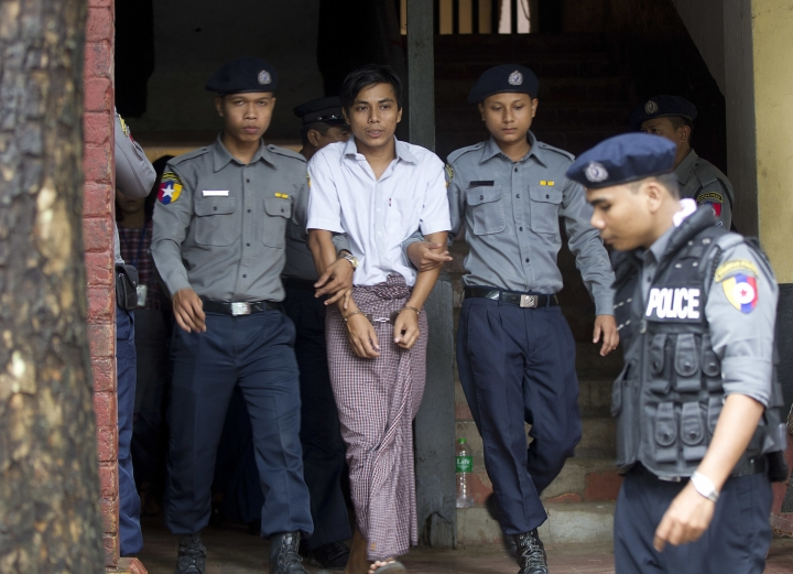 Reuters journalist Kyaw Soe Oo, center, is escorted by polices as they leave the court after their trial Monday, July. 30, 2018, Yangon, Myanmar. The two reporters Wa Lone and Kyaw Soe Oo are accused of illegally possessing official information. (AP Photo/Thein Zaw)