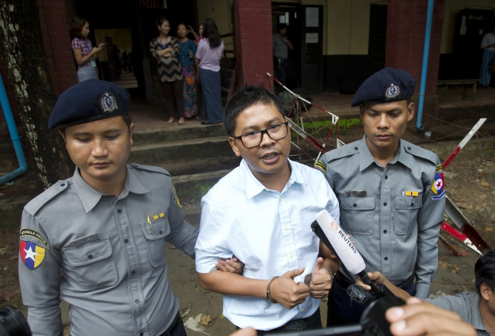 Reuters journalist Wa Lone, center, talks to journalists as they leave the court after their trial while their family members see off in the background Monday, July. 30, 2018, Yangon, Myanmar. The two reporters Wa Lone and Kyaw Soe Oo are accused of illegally possessing official information. (AP Photo/Thein Zaw)