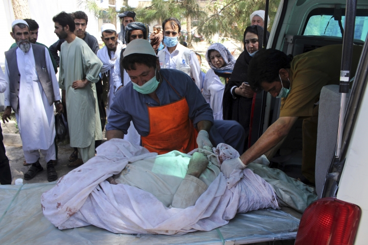Medical personnel transport the body of a bombing victim by ambulance, at a hospital in Herat, Afghanistan, Tuesday, July 31, 2018. The roadside bombing hit a passenger bus in western Afghanistan on Tuesday, killing at least 11 people. (AP Photo)