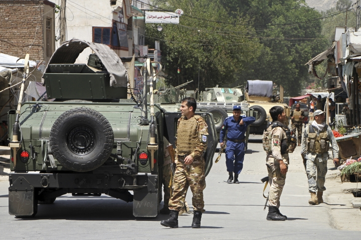 Security forces gather following a deadly attack including a suspected suicide car bombing and gunbattles, in Jalalabad, Afghanistan, Tuesday, July 31, 2018. An Afghan provincial official said a coordinated attack was underway by the Taliban in the city of Jalalabad, the capital of eastern Nangarhar province. (AP Photo)