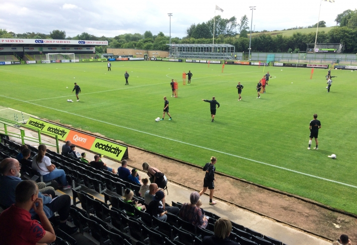 In this Monday, July 30, 2018 photo, players training at The New Lawn, Forest Green Rovers' football ground, in Nailsworth, England. An English soccer club has become the first professional sports team in the world to be certified as carbon neutral by the United Nations. (AP Photo/James Brook)