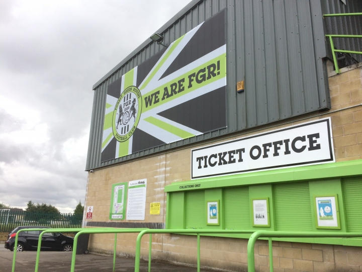 In this Monday, July 30, 2018 photo, a view of ticket office at the New Lawn, Forest Green Rovers' football ground, in Nailsworth, England. An English soccer club has become the first professional sports team in the world to be certified as carbon neutral by the United Nations. (AP Photo/James Brook)