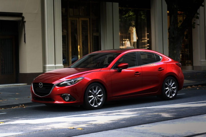This photo provided by Mazda shows the 2014 Mazda 3, which Edmunds highlights as one of the best compact cars. The Mazda 3's handling and materials quality are among the best in the class, and its range of body styles, powertrains and trims means there's a model to fit most budgets. (Courtesy of Mazda North American Operations via AP)