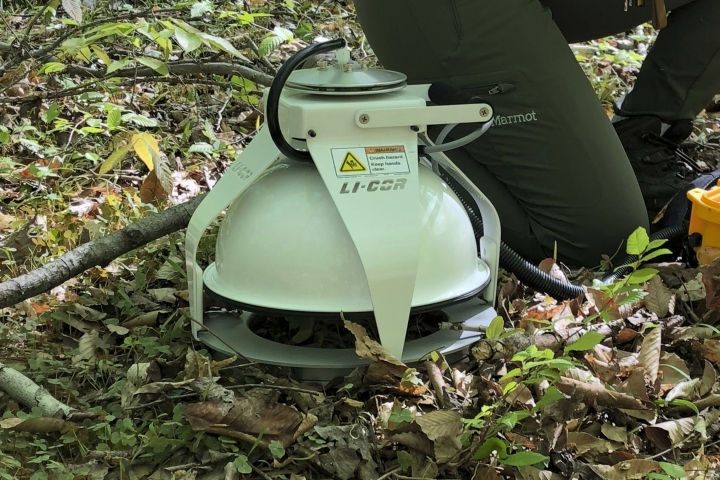 This May 3, 2018 photo provided by Benjamin Bond-Lamberty shows a device measuring the amount of carbon dioxide released into the air from the soil at the Smithsonian Environmental Research Center near Edgewater, Md. Observations from across the globe show that as temperatures have warmed, bacteria and fungi in the soil are becoming more active. These turbo-charged microbes are feeding on dead leaves and plants, releasing more heat-trapping carbon dioxide into the air, according to a study in the Wednesday, Aug. 1, 2018 edition of the journal Nature. (Benjamin Bond-Lamberty via AP)
