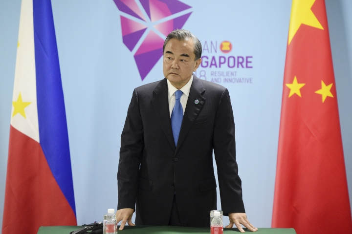 China's Foreign Minister Wang Yi pauses before a bilateral meeting with Philippines' Foreign Affairs Secretary Alan Cayetano on the sidelines of the 51st ASEAN Foreign Ministers Meeting in Singapore, Thursday, Aug. 2, 2018. (AP Photo/Joseph Nair)