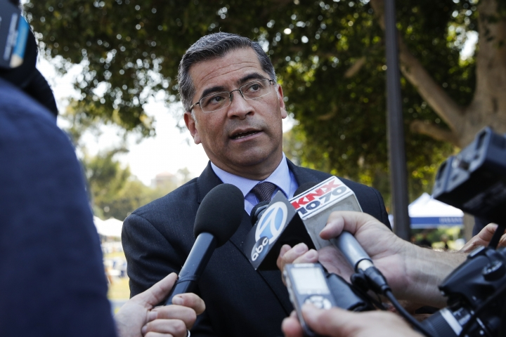 California Attorney General Xavier Becerra talks to reporters after a news conference at University of California, Los Angeles Thursday, Aug. 2, 2018. Becerra spoke about his efforts to fight the Trump administration's proposal to weaken car efficiency fuel standards. (AP Photo/Jae C. Hong)