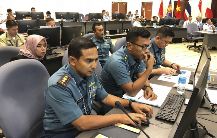 Indonesian Navy staff participate in a computer-simulated drill in Singapore, Friday, Aug. 3, 2018. Chinese and Southeast Asian naval forces have staged their first computer-simulated drills so they can jointly respond to emergencies and build trust amid the long-seething disputes in the South China Sea. The two-day exercises that ended Friday involved more than 40 sailors from China and the 10-member Association of Southeast Asian Nations. (AP Photo/Jim Gomez)