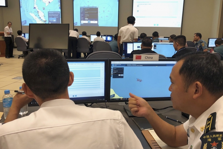 Chinese navy staff participate in a computer-simulated drill in Singapore, Friday, Aug. 3, 2018. Chinese and Southeast Asian naval forces have staged their first computer-simulated drills so they can jointly respond to emergencies and build trust amid the long-seething disputes in the South China Sea. The two-day exercises that ended Friday involved more than 40 sailors from China and the 10-member Association of Southeast Asian Nations. (AP Photo/Jim Gomez)
