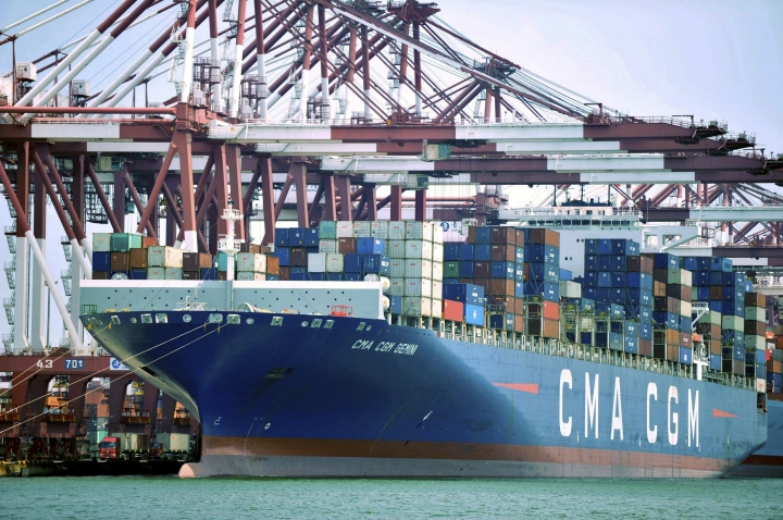 FILE - In this July 6, 2018, file photo, a container ship is docked at a port in Qingdao, in eastern China's Shandong Province. The Trump administration is proposing raising planned taxes on $200 billion in Chinese imports to 25 percent from 10 percent, turning up the pressure on Beijing in a trade war between the world's two biggest economies. (Chinatopix via AP, File)
