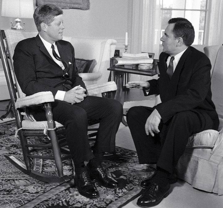 FILE - In this Oct. 6, 1961, file photo, President John F. Kennedy, left, sits in his rocker in the White House in Washington, as he talks with Soviet Foreign Minister Andrei Gromyko about the Berlin situation. Beginning Friday, Aug. 3, 2018, Eldred's auction gallery in East Dennis, Mass., on Cape Cod, is auctioning items associated with the late president, including a rocking chair that Kennedy used in the White House. (AP Photo/Bob Schutz, File)