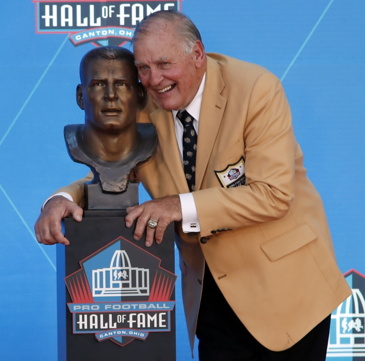 Former NFL player Jerry Kramer poses with a bust of himself during inductions at the Pro Football Hall of Fame, Saturday, Aug. 4, 2018 in Canton, Ohio. (AP Photo/Gene J. Puskar)