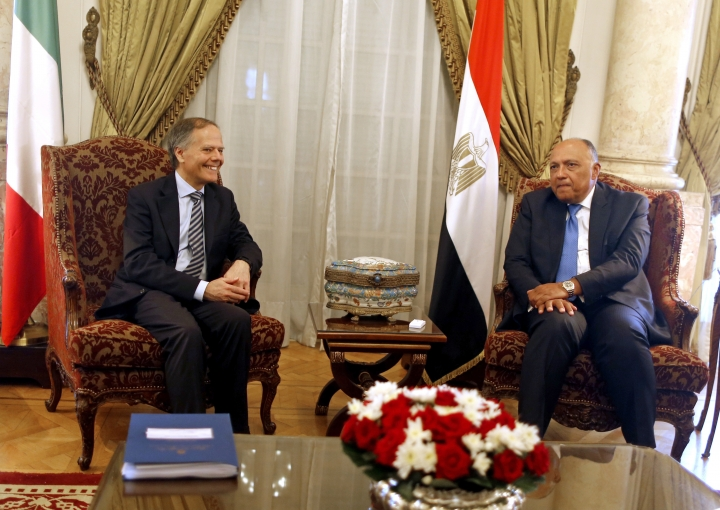 Italian Foreign Minister Enzo Moavero Milanesi, left, meets with his Egyptian counterpart, Sameh Shoukry, at Tahrir Palace, in Cairo, Egypt, Sunday, Aug. 5, 2018. (AP Photo/Amr Nabil)