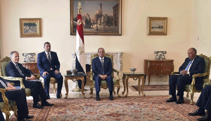 """In this photo released by the Egyptian Presidency, Egyptian President Abdel-Fattah el-Sissi, center, and Foreign Minister Sameh Shoukry, right, meet with Enzo Moavero Milanesi, Italy's foreign minister, left, in Cairo, Egypt, Sunday, Aug. 5, 2018. It was the first visit by an Italian top diplomat since the 2016 murder in Cairo of Giulio Regeni, an Italian graduate student. Milanesi said at a news conference with Shoukry that they discussed """"important"""" topics including Libya, illegal migration and the murder of Regeni. (Egyptian Presidency via AP)"""