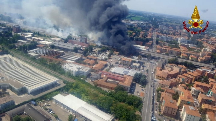 In this photo released by the Italian firefighters, an helicopter view of the explosion on a highway in the outskirts of Bologna, Italy, Monday, Aug. 6, 2018. The explosion was reportedly caused by an accident involving a truck that was transporting flammable substances and exploded upon impact. (Vigili Del Fuoco via AP)