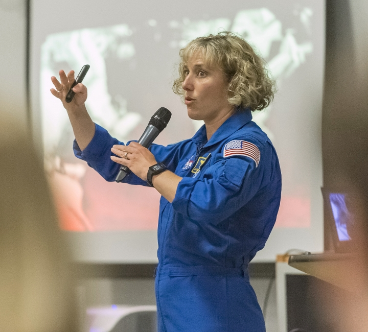 In this July 13, 2018 photo, NASA astronaut Dottie Metcalf-Lindenburger discusses space travel and her experiences in space at the U.S. Space & Rocket Center in Huntsville, Ala. Huntsville's tourism industry is rooted in the U.S. space program and its critical, ongoing research into getting astronauts back to the moon and on to Mars. (AP Photo/Vasha Hunt)
