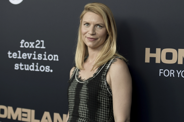 "FILE - In this Tuesday, June 5, 2018 file photo, Claire Danes attends the ""Homeland"" FYC Event at the Writers Guild Theater in Beverly Hills, Calif. Showtime announced Monday, Aug. 6, 2018, that its acclaimed series ""Homeland"" will end in 2019 with its eighth season. Danes stars in ""Homeland,"" which has taken her bipolar, now former CIA agent Carrie through dangerous conflicts that sometimes mirrored real-world events. (Photo by Richard Shotwell/Invision/AP, File)"