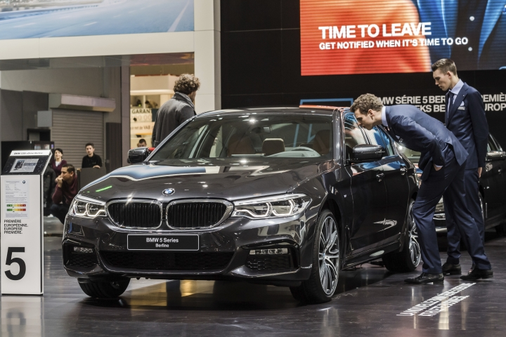 "FILE- In this Jan. 13, 2017, file photo men look at a BMW 5 series during the media day of the 95th European Motor Show in Brussels. The Insurance Institute for Highway Safety, in a paper titled ""Reality Check,"" issued the warning Tuesday, Aug. 7, 2018, after testing five of the systems from Tesla, Mercedes, BMW and Volvo on a track and public roads. The systems tested, in the Tesla Model 3 and Model S, BMW's 5-Series, the Volvo S-90 and the Mercedes E-Class, are among the best in the business right now and have been rated ""superior"" in previous IIHS tests. David Zuby, the institute's chief research officer, said the systems do increase safety but the tests show they are not 100 percent reliable. (AP Photo/Geert Vanden Wijngaert, File)"