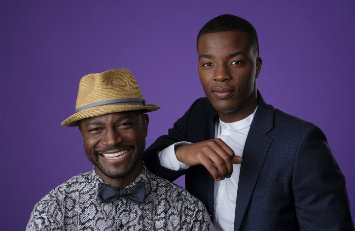 """Taye Diggs, left, and Daniel Ezra, cast members in the CW series """"All American,"""" pose together for a portrait during the 2018 Television Critics Association Summer Press Tour, Monday, Aug. 6, 2018, in Beverly Hills, Calif. (Photo by Chris Pizzello/Invision/AP)"""