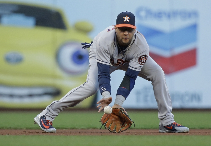 Houston Astros third baseman Yuli Gurriel fields a ground ball hit by the San Francisco Giants' Buster Posey to begin a double play in the first inning of a baseball game Monday, Aug. 6, 2018, in San Francisco. (AP Photo/Eric Risberg)
