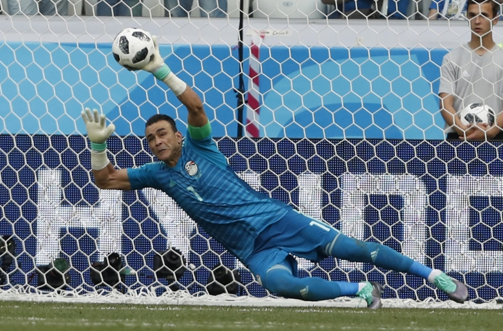FILE - In this file photo dated Monday, June 25, 2018, Egypt goalkeeper Essam El Hadary deflects a penalty during the group A match between Saudi Arabia and Egypt at the 2018 soccer World Cup at the Volgograd Arena in Volgograd, Russia. In a social media announcement, the 45-year old Egypt goalkeeper Essam El Hadary said he is retiring from the national team after becoming the oldest man to play in a World Cup match. (AP Photo/Darko Vojinovic, FILE)