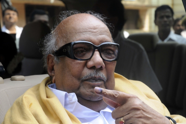FILE- In this May 13, 2009 file photo, Tamil Nadu state's then Chief Minister Muthuvel Karunanidhi displays the indelible ink mark on his finger after casting his vote at a polling booth in Chennai, India. Karunanidhi, a scriptwriter-turned-politician in the southern Indian state of Tamil Nadu, has died after a prolonged illness. He was 94. (AP Photo, File)