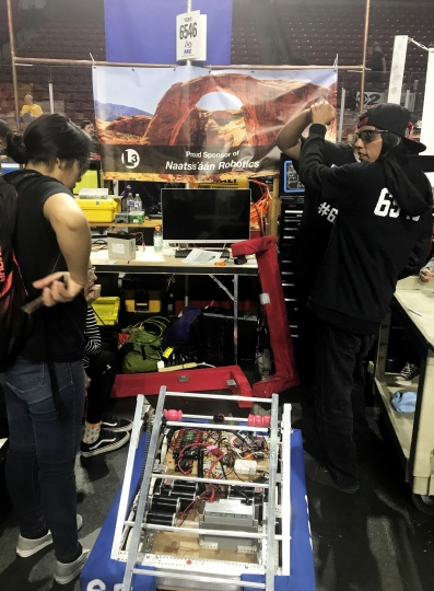 This March 3, 2018 photo provided by Heather Anderson shows from left, Navajo Mountain High School students Nahida Smith and Cuay Bitsinnie compete in a Utah regional robotics competition in West Valley City, Utah. The team from a remote town in southern Utah is now headed to an international robotics competition Aug. 14 in Mexico City, Mexico. They were invited to compete in the First Global Challenge, which will draw teams from 190 countries to create robots capable of feeding power plants and building environmentally efficient transmission networks. (Heather Anderson via AP)
