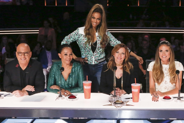 "This image released by NBC shows the judges, from left, Howie Mandel, Mel B, host Tyra Banks, guest judge Martina McBride and judge Heidi Klum on the set of ""America's Got Talent,"" in Thousand Oaks, Calif. The Nielsen company said Tuesday the network was led, as usual in the summer months, by ""America's Got Talent."" The competition show was seen by 11.8 million people last week, more than four million more than anything else on television. (Photo by: Vivian Zink/NBC)"