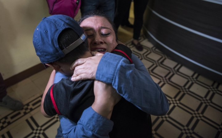 "Lourdes de Leon hugs her 6-year-old son Leo Jeancarlo de Leon as they are reunited at the shelter ""Nuestras Raíces"" in Guatemala City, Tuesday, Aug. 7, 2018. De Leon said she and Leo had gone to the U.S. in search of a better life because her low-paid job selling clothing wasn't enough to provide him with a good future. They arrived in Arizona on May 10, and the boy was taken from her a couple of days later. She was returned to Guatemala on June 7, while he remained in a shelter in New York. (AP Photo/Oliver de Ros)"