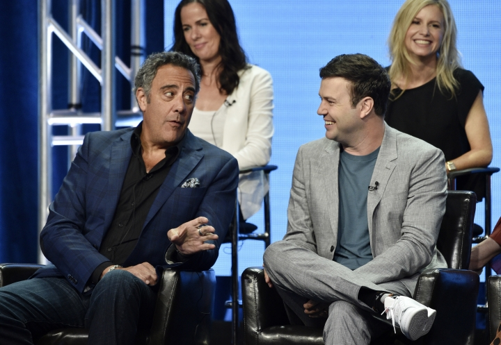 """Brad Garrett, left, a cast member in the Disney ABC television series """"Single Parents,"""" gestures to fellow cast member Taran Killam, right, as executive producer Katherine Pope, top left, and co-creator/executive producer JJ Philbin look on during the 2018 Television Critics Association Summer Press Tour, Tuesday, Aug. 7, 2018, in Beverly Hills, Calif. (Photo by Chris Pizzello/Invision/AP)"""