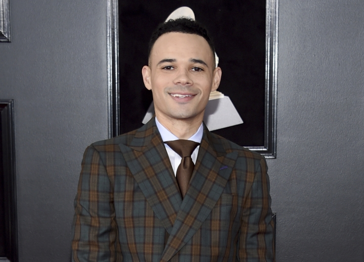 FILE - In this Jan. 28, 2018 file photo, Tauren Wells arrives at the 60th annual Grammy Awards in New York. Wells received seven Dove Awards nominations including one for song of the year and new artist of the year. The Gospel Music Association announced the nominees on Wednesday for their 49th Annual GMA Dove Awards to be held on Oct. 16 in Nashville, Tenn. (Photo by Evan Agostini/Invision/AP, File)