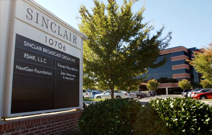 FILE - In this Oct. 12, 2004, file photo, Sinclair Broadcast Group, Inc.'s headquarters stands in Hunt Valley, Md. Broadcasting company Sinclair says it's in talks with Tribune Media Co. on how to overcome regulatory hurdles to its $3.9 billion deal to buy 42 of Tribune's TV stations. Sinclair CEO Chris Ripley said Wednesday, Aug. 8, 2018, that the companies are working to find approaches that are best for the company, employees and shareholders. (AP Photo/Steve Ruark, File)