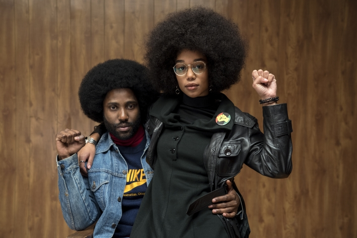 "This image released by Focus Features shows John David Washington, left, and Laura Harrier in a scene from ""BlacKkKlansman."" (David Lee/Focus Features via AP)"