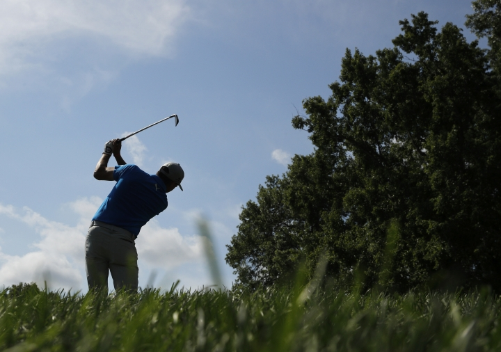 Rickie Fowler hits on the 16th hole during a practice round for the PGA Championship golf tournament at Bellerive Country Club, Wednesday, Aug. 8, 2018, in St. Louis. (AP Photo/Charlie Riedel)