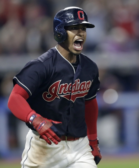 Cleveland Indians' Francisco Lindor celebrates after hitting a game-winning three-run home run off Minnesota Twins relief pitcher Trevor Hildenberger during the ninth inning of a baseball game Wednesday, Aug. 8, 2018, in Cleveland. The Indians won 5-2. (AP Photo/Tony Dejak)