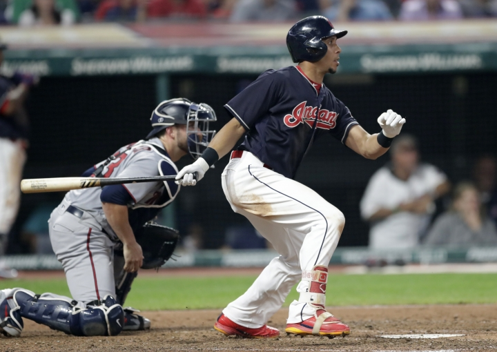 Cleveland Indians' Michael Brantley grounds out against Minnesota Twins starting pitcher Jake Odorizzi during the sixth inning of a baseball game, Wednesday, Aug. 8, 2018, in Cleveland. A run scored. (AP Photo/Tony Dejak)
