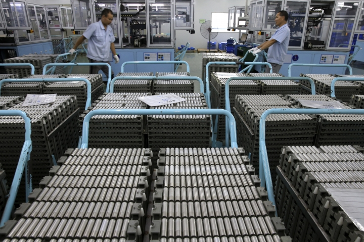 In this July 27, 2018, photo, workers transfer Lithium-ion batteries in a factory in Taizhou in east China's Jiangsu province. China's exports accelerated in July, showing little impact from a U.S. tariff hike, while sales to the United States rose 13.3 percent over a year earlier. (Chinatopix via AP)