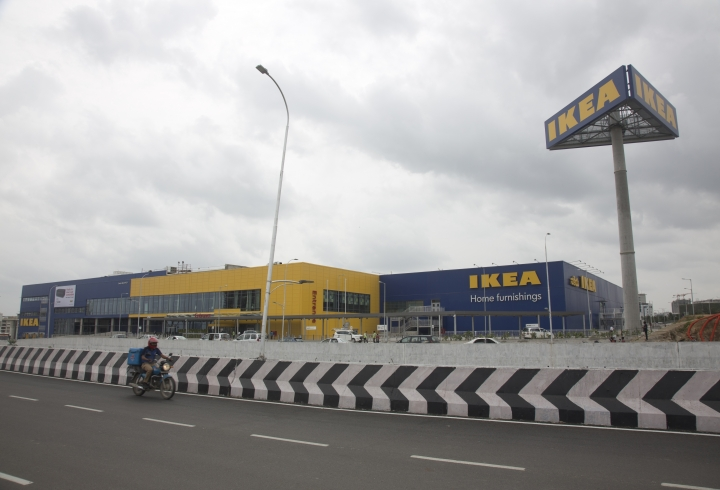 A motorist rides past India's first IKEA store ahead of its opening in Hyderabad, India, Wednesday, Aug.8, 2018. The Swedish furniture giant opens doors of its first store in India on Thursday. (AP Photo/Mahesh Kumar A.)