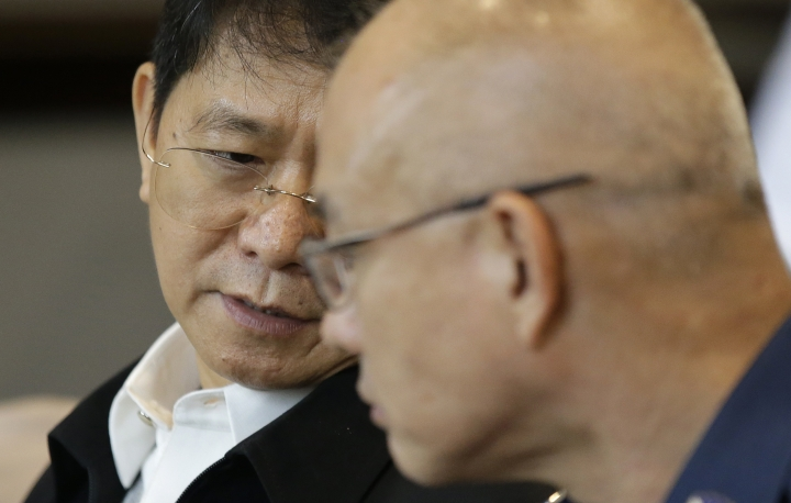 Philippine Interior Undersecretary Eduardo Ano, left, talks with Philippine National Police Chief Gen. Oscar Albayalde during a meeting in Manila, Philippines on Thursday, Aug. 9, 2018. Ano said a foreign militant was behind a powerful van blast that targeted a big public gathering but failed after the vehicle stalled and instead killed the suspect and 10 others. (AP Photo/Aaron Favila)