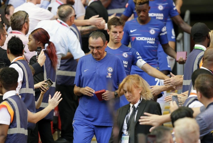 Chelsea's manager Maurizio Sarri walks after Chelsea collected their second place medals after they lost the Community Shield soccer match between Chelsea and Manchester City at Wembley, London, Sunday, Aug. 5, 2018. (AP Photo/Tim Ireland)