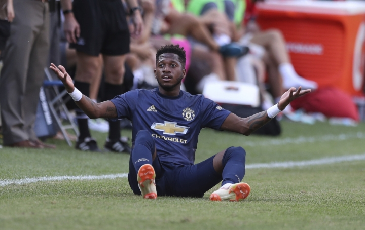 FILE - In this Saturday, July 28, 2018 file photo, Manchester United's Fred looks on during their International Champions Cup tournament soccer match against Liverpool, in Ann Arbor, Mich. The summer transfer window has been shortened in the Premier League to close on Thursday, Aug. 9 before the season starts. Joining from Shakhtar Donetsk for $66 million, Fred likely will take up a position in midfield alongside anchorman Nemanja Matic and also Pogba, who should play in his preferred place on the left of a central three and have fewer defensive responsibilities. (AP Photo/Carlos Osorio, file)