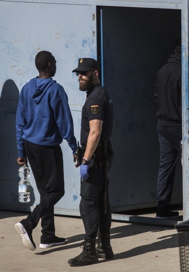 Migrants are led into the Migrants Reception Center near Algerciras, Spain, Thursday, Aug. 9, 2018. A rescue boat operated by Spanish aid group Proactiva Open Arms carrying 87 African migrants and refugees saved in the Mediterranean Sea has docked at the southern Spanish port of Algeciras after other, geographically closer, European Union countries refused to let it dock amid continuing strain between governments about how to respond to the wave of migrants crossing from Africa. (AP Photo/Javier Fergo)