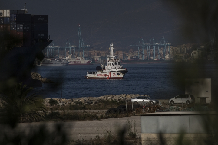 The Open Arms Search and Rescue vessel arrives in Algeciras, Spain, Thursday, Aug. 9, 2018. A rescue boat operated by Spanish aid group Proactiva Open Arms carrying 87 African migrants and refugees saved in the Mediterranean Sea has docked at the southern Spanish port of Algeciras after other, geographically closer, European Union countries refused to let it dock amid continuing strain between governments about how to respond to the wave of migrants crossing from Africa. (AP Photo/Javier Fergo)
