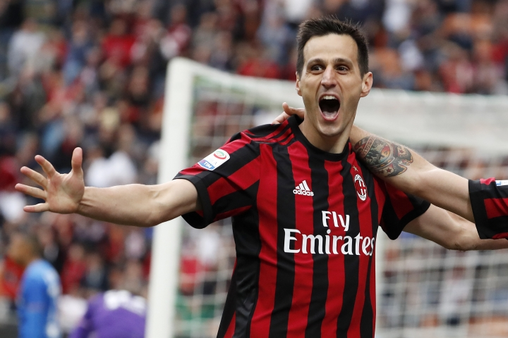 In this Sunday, May 20, 2018 file photo, AC Milan's Nikola Kalinic celebrates after scoring his side's third goal during the Serie A soccer match between AC Milan and Fiorentina at the San Siro stadium in Milan, Italy. Atletico Madrid has signed, Thursday, Aug. 9, 2018, a three-year deal with Croatia forward Kalinic from AC Milan. (AP Photo/Antonio Calanni, Files)
