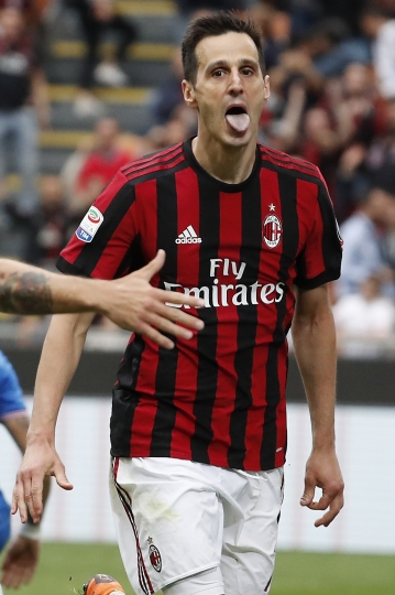 In this , Sunday, May 20, 2018 file photo, AC Milan's Nikola Kalinic celebrates after scoring his side's third goal during the Serie A soccer match between AC Milan and Fiorentina at the San Siro stadium in Milan, Italy. Atletico Madrid has signed, Thursday, Aug. 9, 2018, a three-year deal with Croatia forward Kalinic from AC Milan. (AP Photo/Antonio Calanni)