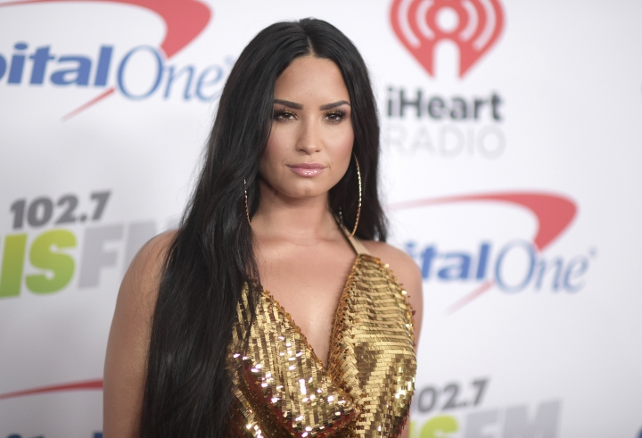FILE - In this Dec. 1, 2017 file photo, Demi Lovato arrives at Jingle Ball at The Forum in Inglewood, Calif. Lovato has canceled the rest of her fall tour to focus on her recovery. Over the weekend Lovato checked out of the hospital she was rushed to on July 24 for a reported overdose. (Photo by Richard Shotwell/Invision/AP, File)