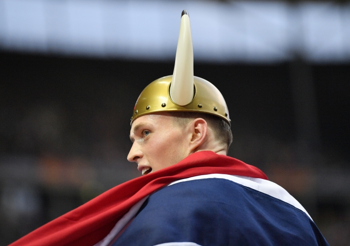 =Norway's Karsten Warholm celebrates after winning the gold medal in the men's 400-meter hurdles final at the European Athletics Championships at the Olympic stadium in Berlin, Germany, Thursday, Aug. 9, 2018. (AP Photo/Martin Meissner)
